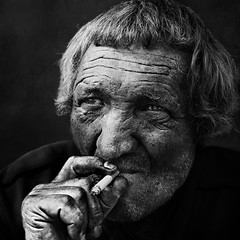 Outdoor portrait (Ales Dusa) Tags: outdoor outdoorportrait streetportrait streetshot man cigarette smoker homeless canon5d ef50mmf18stm alesdusa strongcontrast charismaticman wrinkledman wrinkles people human face facial person monochrome bw hand