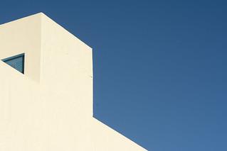White building, blue door