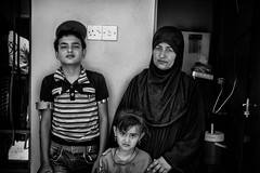 She was walking home with her daughter when a bomb fell on her house, killing her husband and two sons. Her third son survived but will walk on crutches for the rest of his life. (rvjak) Tags: irak iraq kurdistan daesh isis bomb bombe black white bw noir blanc family famille mère mother daughter son fils fille enfant kid d750 nikon middleeast moyenorient three trois survivors survivants war guerre child