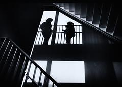 Meeting in the stairway (andzwe) Tags: deplataan meppel stairway trapportaal ontmoeting meeting silhouette blackandwhite monochrome women girls scala wajang poppenspel silhouettes plataan centrumvoordekunsten muzischcentrum cultureelcentrum hal gang motoxstyle photo motorola