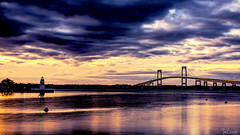 Goat Island Light and Pell Bridge (Ian Charleton) Tags: goatisland lighthouse goatislandlight newportbridge pellbridge bridge suspensionbridge water reflection sky longexposure hdr bay narragansettbay sunset