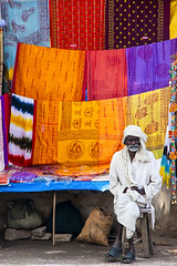 Colours of India! (Dick Verton ( more than 12.000.000 visitors )) Tags: market sarishop man white colours streetview streetshot streetphotographer varanasi india travel asia people sit sitting seated