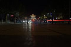 train station (Notquiteahuman1) Tags: pavement evening night dark clock trainstation longexposure lighttrails city urban cars street trees poles light contrast noite luz red white black blue relógio rua reflection vermelho azul branco