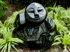 Down to Earth (Steve Taylor (Photography)) Tags: art digital sculpture carving black brown green grey stone rock lady asia singapore plant foliage flax texture african flowerdome gardensbythebay chapungusculpturemovement springstone zimbabwe
