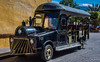 2017 - Mexico - Tequila - Tourist Train (Ted's photos - For Me & You) Tags: 2017 cropped mexico nikon nikond750 nikonfx tedmcgrath tedsphotos tedsphotosmexico tequila vignetting tequilajalisco tequilapuebomágico magictownsofmexico pueblomágico pueblosmagicos santiagodetequila bus touristbus engine vehicle streetscene street seating seats emptyseats cowcatcher wheels headlights 501 arches curb yellowline shadow step runningboard