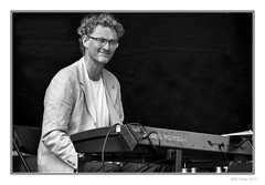 The Keyboardist (Seven_Wishes) Tags: newcastleupontyne canoneos5dmarkiv canonef100400mmf4556lisii outdoor photoborder newcastlemela mela2017 music musicians entertainers people portrait candid musician keyboard man bw mono monochrome blackandwhite curlyhair glasses keyboardist entertainer performer