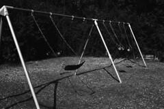 Ferrania P30 Alpha Test Roll 1: Ghost Swing (pmvarsa) Tags: summer 2017 analog film 35mm 135 ferrania p30 alpha 80iso ferraniap30alpha blackandwhite bw nikkormat ftn classic camera nikkormatftn nikon nikkor 35mmf28lens nikonsupercoolscan9000ed coolscan outside cans2s waterloo ontario canada greenspace neighbourhood suburbia leaves trees ghosts mood swings childrens playground