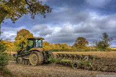 Autumn Ploughing (EVERY SO OFTEN) Tags: modern tracked tractor ploughing field november chilterns buckinghamshire england uk cat outdoors daylight arable agriculture farming farm rural countryside autumn fall leaves trees landscape plough machine machinery powerful strong pull till prepare traditional lifestyle farmer drive colour straw stubble ground soil fertile oak holly furrows lines sonya7r fe35mm