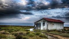 Sans attache... (Fred&rique) Tags: lumixfz1000 photoshop hdr aude gruissan cabne pêcheurs étang nauges orage ciel paysage nature architecture maison