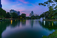 Sunset - Lumphinee (technodude67) Tags: cityview amazingthailand architecture asia bangkok city cityscape colourful lake landscape light longexposure nature night panorama park reflection scenery sky skyline sunset th thailand travel tree urban water krungthepmahanakhon twilight wanderlust