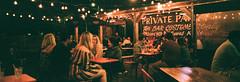 Mercury Burger & Bar (Travis Estell) Tags: 35mmfilm detroit detroitonfilm fujinatura1600 hasselbladxpanii mercuryburgerbar michigan michiganonfilm natura1600 thedarkroom thedarkroomlab xpanii film patio unitedstates us