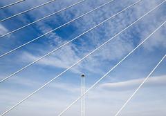 SOLITUDE | Magány (krisztian brego) Tags: olympus omd em1 mzuiko digital 714mm f28 pro budapest megyeri bridge híd sky construction street lamp clouds architecture