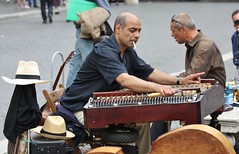 Rome Piazza Navona - May 2015 - Tuning-Up (Gareth1953 All Right Now) Tags: rome musician keyboard smoking band panamahat portrait man candid dof bokeh people sit sitting seated