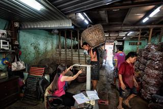Peasant weighing manioc