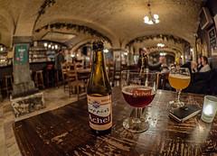 Bottle of Trappist Achel Bruin (8%) Cellar Bar - t'Poatersgat (Bruges - Belgium) (High ISO) Olympus OM-D EM1 -II & M.Zuiko 8mm f1.8 Fisheye Prime)  (1 of 1) (markdbaynham) Tags: bruges brugge bruggen brugse city urban metropolis flanders westflanders flemish fisheyeview highiso olympus omd em1 em1ii em1mk2 csc mirrorless mft m43 m43rd mzd mz zd mzuiko 8mm f18 fisheye prime micro43 micro43rd achel bruin beer ale tpoatersgat pub