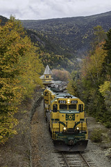 Notch Train departing Crawford Station (Thomas Coulombe) Tags: conwayscenic conwayscenicrailroad csrx emdgp38 gp38 mainecentral mec mountaindivision crawfordstation crawfordnotch newhampshire fallcolors autumnfoliage passengertrain train
