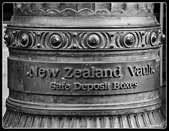 Keep It Safe (PEN-F_Fan) Tags: building olympuspenf on1photoraw auckland film 400ilforddelta monochrome preset raw column frame blackandwhite northisland mzuiko12100mmpro border filmlook newzealand photography on1photoraw2018 processingsoftware sign writing
