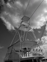 MEN AND THEIR TOYS (NC Cigany) Tags: impressive bw blackwhite marina nc beaufort expensive fishing boat man