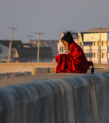 Red Blanket (t0nyn) Tags: people sitting dawn girl seawall houses sunlight