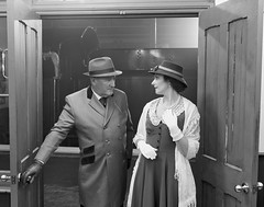 Brief Encounter - black and white. (f22photographie) Tags: timelineevent transport lighting reenactors museum steamswindon people nightphotography darkness railways station stationplatform stationwaitingroom hats shawl necklace smartlydressed gloves blackandwhite monochrome steppingbackintime