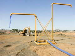 glg-bypass-9910-ps-w (pw-pix) Tags: geelong geelongbypass geelongringroad road construction earthworks victoria australia standpipe water hose pipe valves excavator gravel clay soil rock landscape trees formergeelongcementworks fyansford blue yellow brown grey peterwilliams pwpix wwwpwpixstudio pwpixstudio