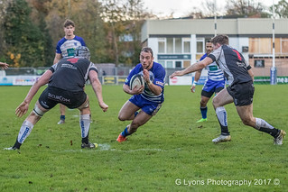 Matthew Bradley takes on Luctonians' Lawrence Breese and Sebastian Robinson-Hall-0376