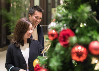 Happy Japanese couple dating in Tokyo at Christmas night