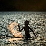 Boy Splashing in Batsi - Andros, Greece thumbnail