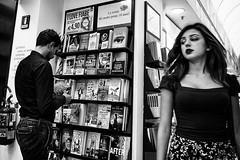 Pheromones (mr.reverend) Tags: ferormon perception woman man books bookstore read couple street streetphoto streetphotography streetlife urban urbanlife candid city citylife rome italy blackandwhite bw monochrome