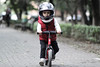 1039 (StriderBikes) Tags: 12 2017 boy brand ducati fullface helmet longsleeve october park photocontestentry red sidewalk striding vest