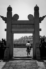 The past traveling door (Go-tea 郭天) Tags: pékin beijingshi chine cn beijing temple of heave ancient candid old door gate rock pavement construction spirit spirituality spiritual cross crossing movement in out back backside backpack tourist touristic tour visitor visiting visit discovering discover alone lonely traditional tradition history historical historic young man street urban city outside outdoor people bw bnw black white blackwhite blackandwhite monochrome naturallight natural light asia asian china chinese canon eos 100d 24mm prime