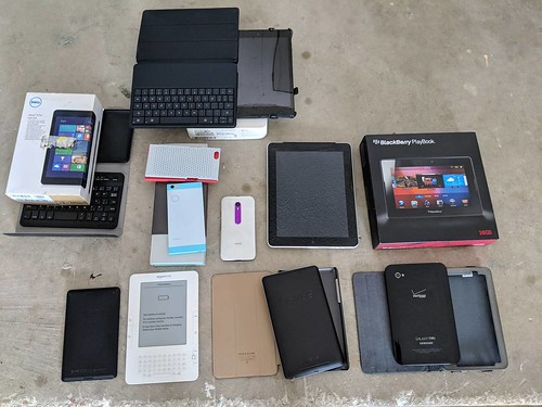 Random old gadgets found in my closet. Dell Venue 8 Pro, Nexus 9 LTE, Blackberry Playbook, original Apple iPad 3G, original Samsung Galaxy Tab, original Nexus 7, Kindle, Kindle Fire, Moto G and Nextbit Robin.