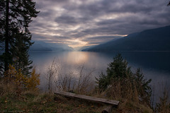 A View over Slocan Lake (SandyK29) Tags: lakecountry britishcolumbia sunrays lake cloudy cloudysky view lakeview valley hills beautyinnature tranquil peaceful contemplative trees bush incrediblesky nikond800 nature log wood shimmery sun sunglow slocan slocanvalley slocanlake