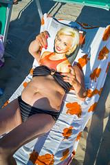 Fake blonde (mr.reverend) Tags: relax woman beachchairs beach newspaper surreal bizarre droll sun reading street streetphoto streetphotography urban urbanlife candid city citylife salento puglia italy colors