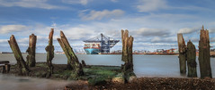 The old and the new (paullangton) Tags: sea felixstowe harbour colour sky blue ship coast wood canon 7dmk2 container cranes clouds