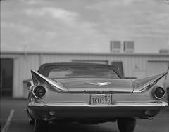 buick on 4x5 film (Garrett Meyers) Tags: garrettmeyers garrett meyers filmphotographer film 4x5film 4x5 graflex graflex4x5 largeformat homedeveloped handheld rbgraflex autograflex4x5 blackandwhite monochrome oldcars vintagecar buick