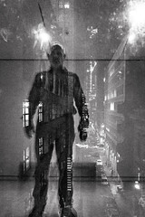 now you're in the sunken place (Super G) Tags: sony009 selfportrait reflection glass window city night edge bw blackandwhite getout partialsilhouette buildings street standing man spc motion blur grain