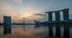 Singapore at sunrise (Lowe_Matthew) Tags: singapore asia sunrise mbs marina bay sands flyer water long exposure sky orange colour light canon lightroom sundaylights