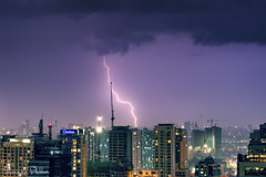 The Tower (Sumarie Slabber) Tags: city lightning weather buildings manila night lights sky