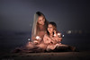 The light (sveta_butko) Tags: sea night outdoor glamour family femininity love mother sensuality long hair childhood dress dream daughter maternity low key fireworks bengal light ethereal purity