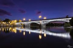 Puente de Triana-Sevilla (Urugallu) Tags: sevila andalucia triana puente rio rioguadalquivir atlantico oceano ocaso luz color hora azul reflejos urugallu joserodriguez canon 70d flickr puentedetriana explore