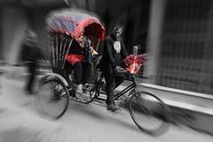 A splash of red (posterboy2007) Tags: kathmandu nepal cycle cyclerickshaw red woman man shopping nepali street rickshaw sony blur