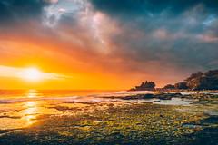 Tanah Lot Sunset (Iftakhar Hasan) Tags: indonesia bali tabanan tanahlot tanahlottemple puratanahlot rockformation beach cloud lightrays sunset sony sonyα6300 sonyepz1650mmf3556oss