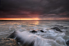 Hayling sunrise (sinky 911) Tags: sunrise seascape colour coast clouds water waves reflections rocks