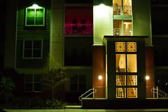 Late Night Walk (dzmears) Tags: lights night apartments colorful sidewalk balcony trees street stairs quaint walking green windows yellow town red