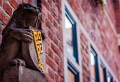 The Gatekeeper (janmalteb) Tags: bremen deutschland germany 50mm bokeh canon eos 1000d brick ziegelsteine schlüssel key coat arms wappen löwe lion stone stein fenster window gold rot red skulptur sculpture statue