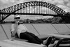 Summer on Sydney Harbour (cupitt1) Tags: girl resting lying talking bridge sydney harbour sunglasses clouds fuji xpro1 lunchtime phone cellphone converse conversation smile smiling