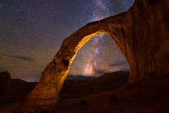 Milky Way Through Corona Arch (NickSouvall) Tags: moab utah desert southwest corona arch arches national park canyon orange rocks light painting milky way astro astrophotography night nightscape stars star clear sky dark warm cool blue purple colorful landscape nature photo photography picture adventure discover explore hike