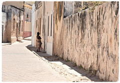 Another Stone Town (The Spirit of the World) Tags: limestone buildings stonetown walls town woman local street cement shadows walkway old tradingpost formerportuguesecolony historica unescoworldheritagesite island islademocambique indianocean africa mozambique