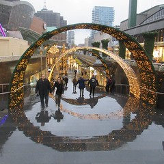 Arches over Beursplein, rainy pavement reflecting, Rotterdam, Netherlands (Paul McClure DC) Tags: rotterdam southholland thenetherlands zuidholland architecture people modern nov2017 reflection netherlands nederland